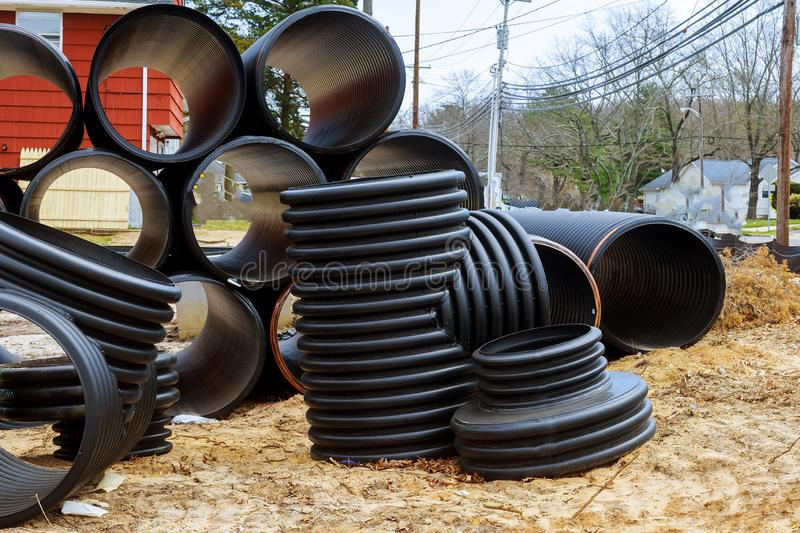 New gray plastic pipes for the sewage system pipes outdoors. New gray plastic pipes for the sewage system preparation for installation pipes outdoors septic royalty free stock image
