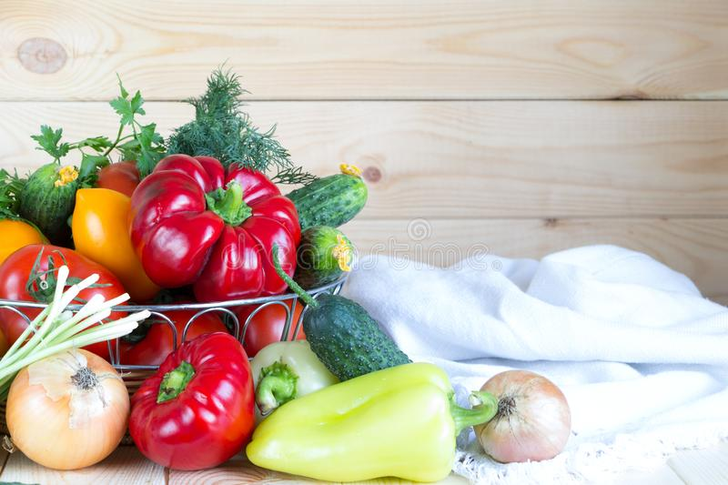 New harvest background with copy space. Fresh vegetables in wicker basket on wooden table. royalty free stock image