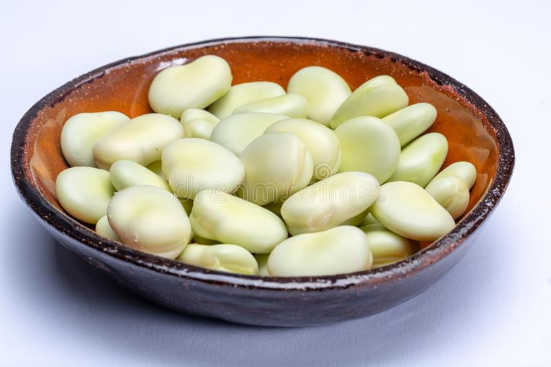 New harvest of healthy vegetables, green fresh raw big broad beans close up isolated on white background stock photography