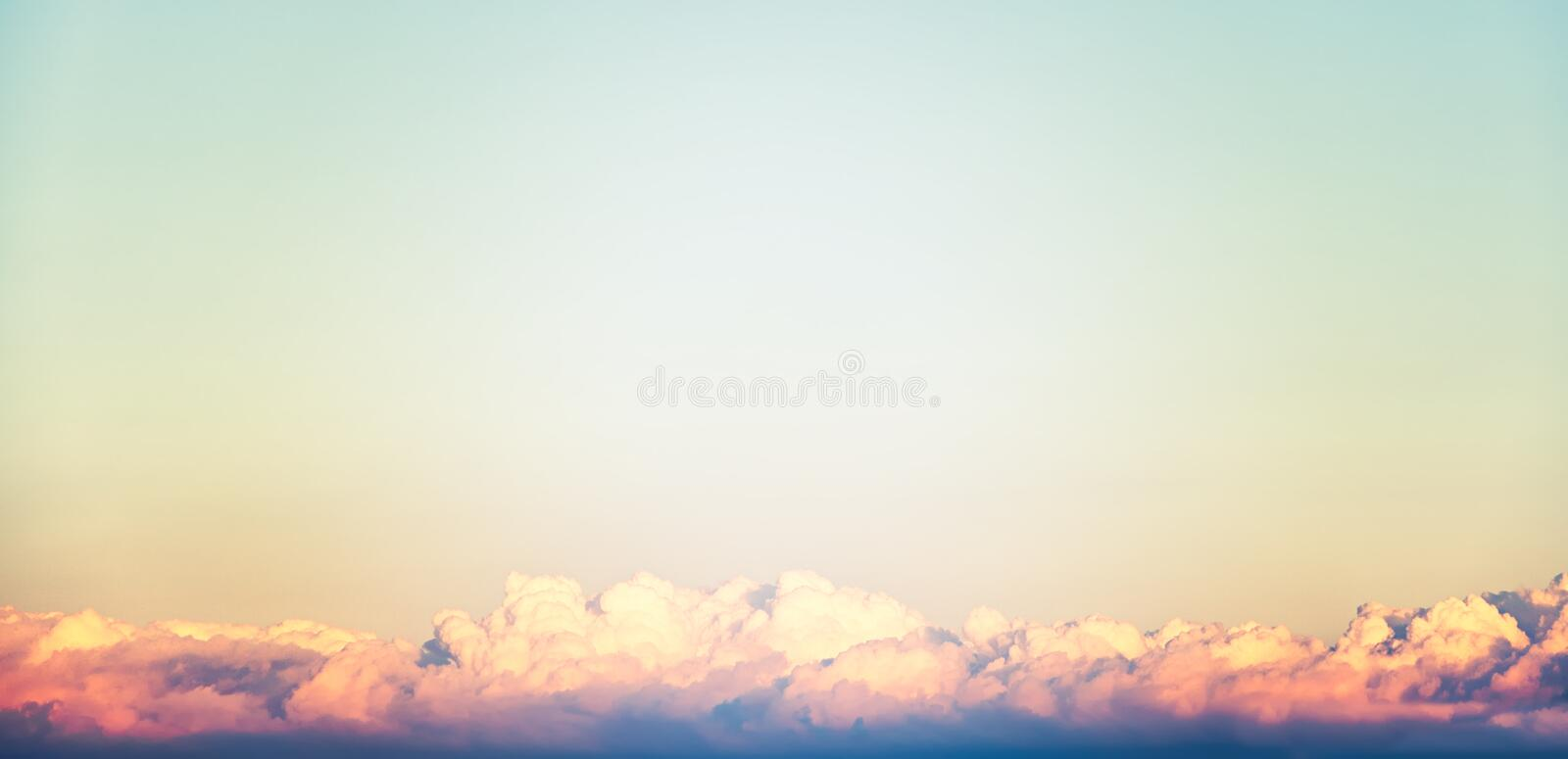 A new heaven and earth concept: Dramatic sun ray with orange sky and clouds dawn texture background with space for text web banner stock photography