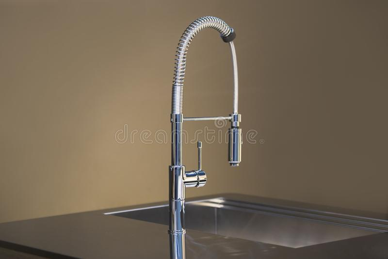 New high kitchen faucet design. Kitchen sink tap mixer stock photography
