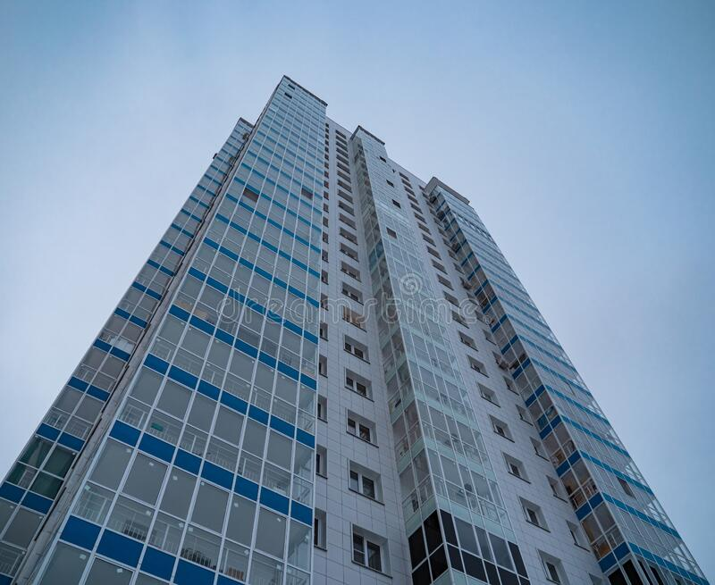 New highrise residential tower on blue sky background. New highrise residential tower on blue sky background royalty free stock images