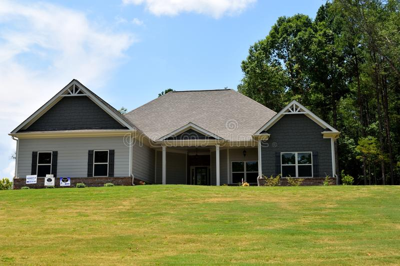 New home in Bogart Georgia. New home on one floor constructed in Bogart, Georgia, United States with lawn already established and trees left intact on the site royalty free stock images