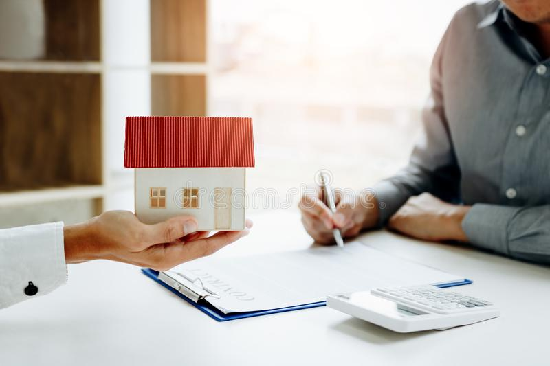 New home buyer signing contract with agents are holding the mode royalty free stock photo