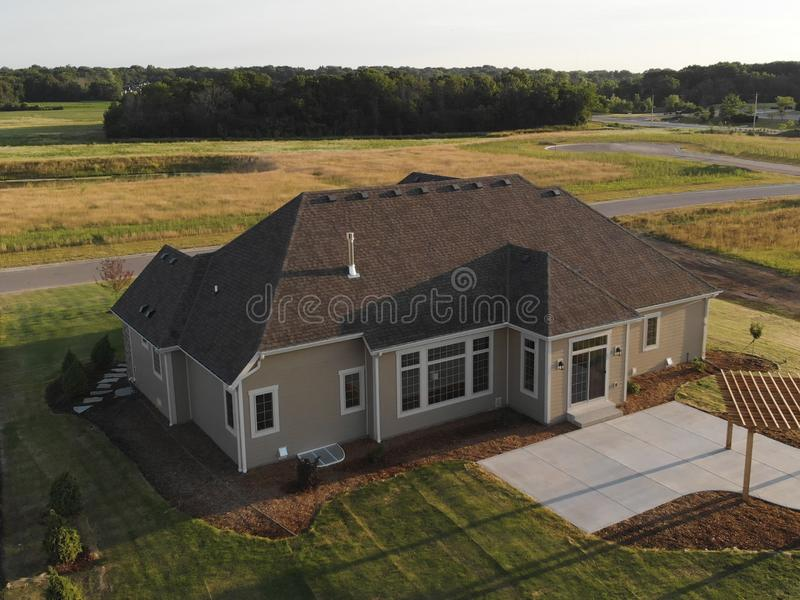 New home construction from above. Aerial view of suburban house. American neighborhood, suburb. Summer, sunny day stock photos