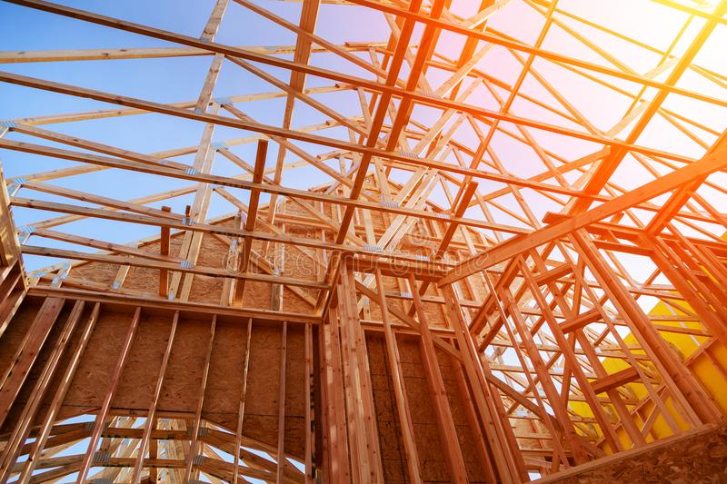 New home construction. build with wooden truss, post and beam framework. New construction home framing New build with wooden truss, post and beam framework stock photography
