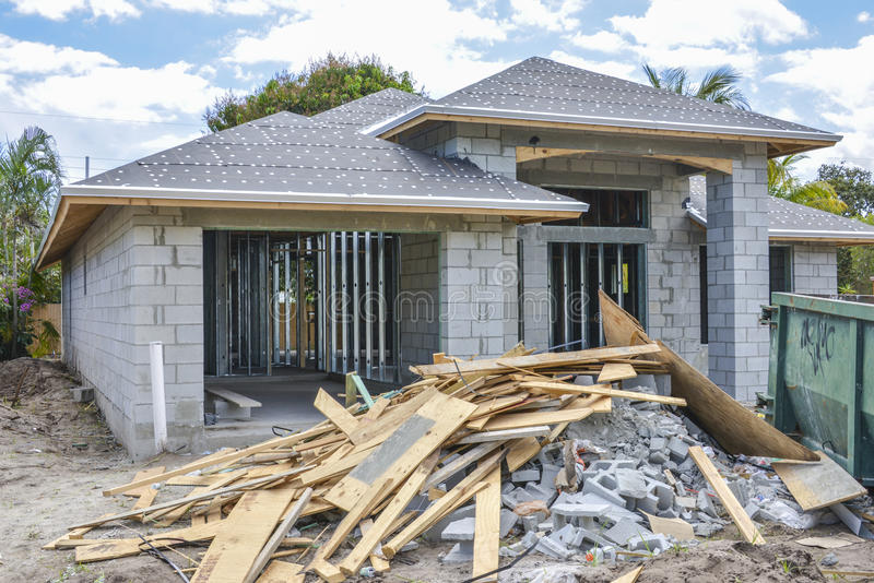 New home and construction debris. A new home and construction site debris near it in Boynton Beach, Florida stock photography