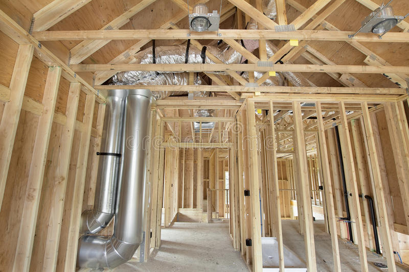 New home construction framed with wood studs stock image for New home heating systems