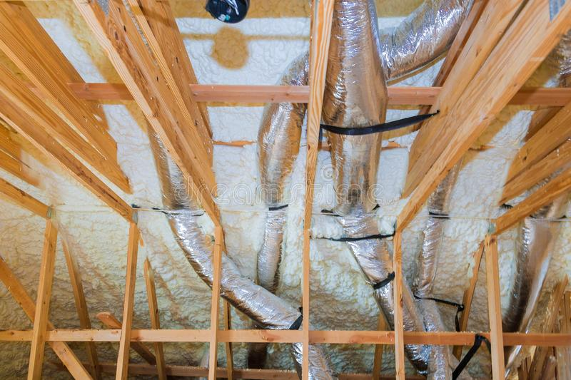 New home construction with installation of heating system on the roof of the pipe. New home construction with selective focus of installation of heating system stock photography