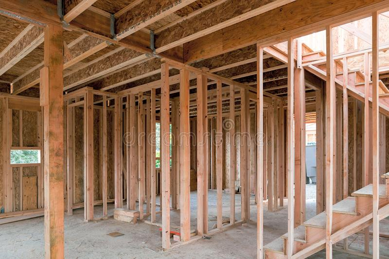 New Home Construction Wood Framing. New home construction interior wood stud framing ceiling beams and stair royalty free stock photos