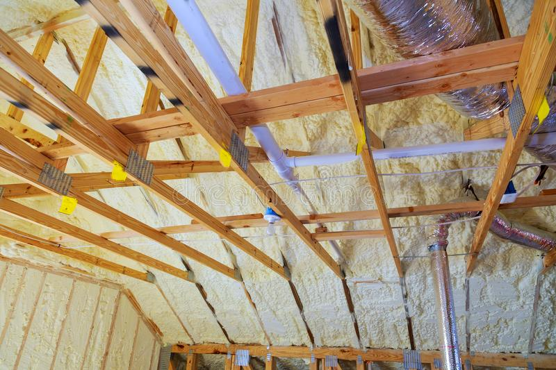 New home construction with selective focus of installed of HVAC vent in roofing rafters. Vent pipes in attic stock photography