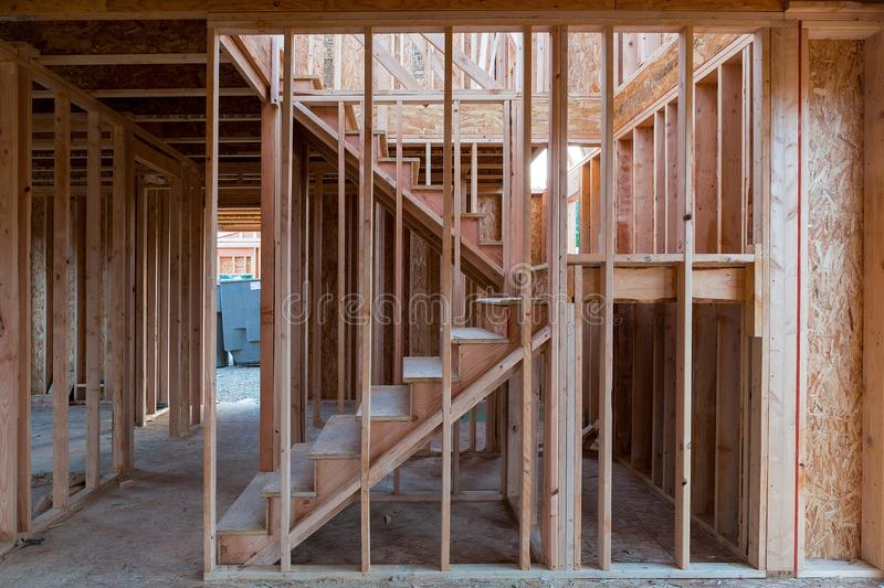 New Home Construction Wood Stud Framing. New home construction interior wood stud framing ceiling beams entryway staircase stock photos