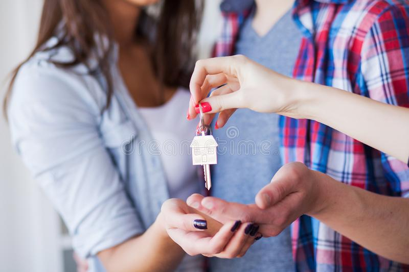New Home. Funny young couple enjoy and celebrating moving to new home. Happy couple at empty room of new home royalty free stock photography