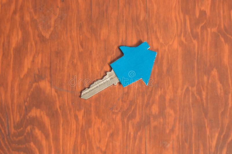 New home keys on wooden desk, real estate concept. Acquisition of a home. With copy space royalty free stock photo