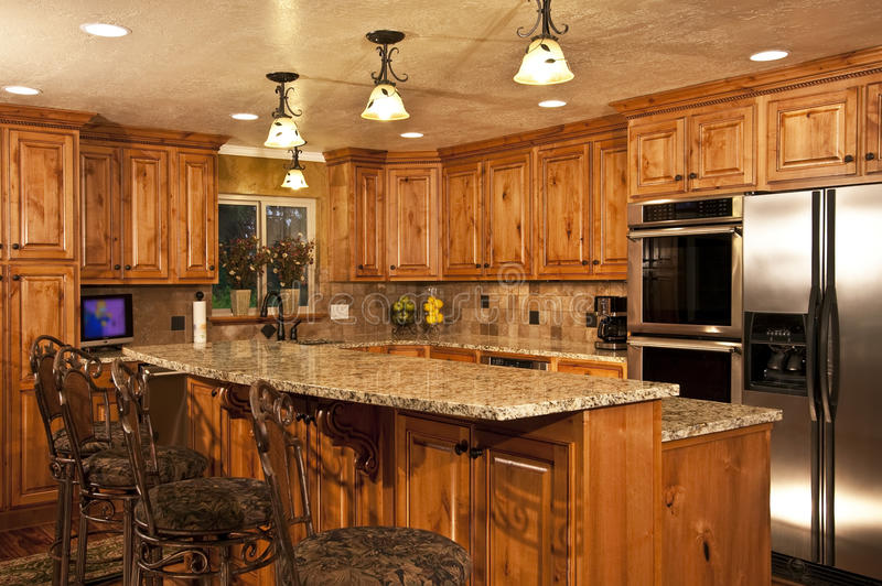 New home kitchen with island royalty free stock photography