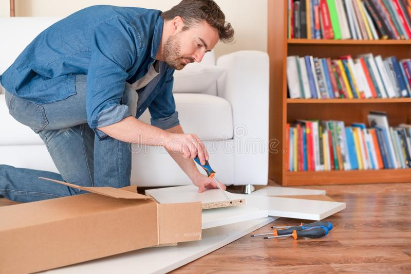 New home and man assembling furniture do it yourself stock images