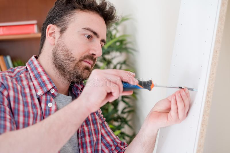 New home and man assembling furniture do it yourself stock photography