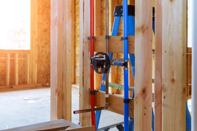 New home plumbing inside a house frame under construction interior. Frame bathroom plumber restroom structure pvc wood design unfinished architecture royalty free stock photo