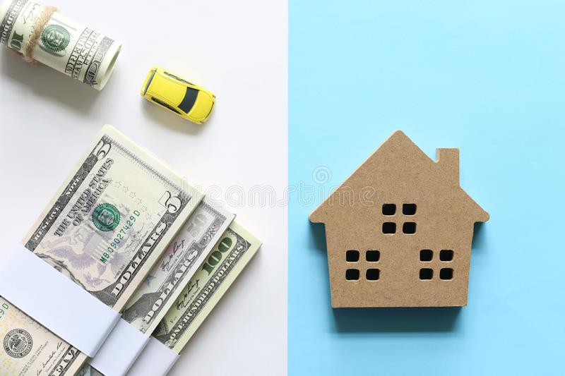 New home and Real estate concept, Model house and banknote on blue background, Finance and Banking stock photos