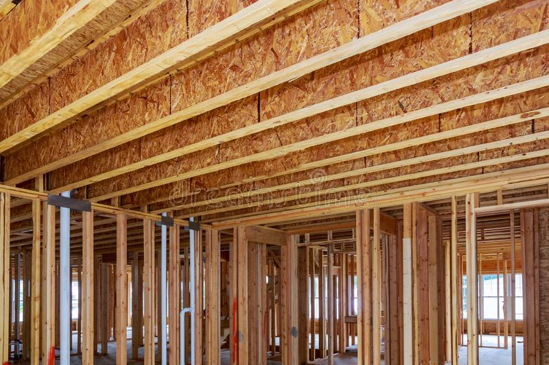 A new home under construction interior and plumbing inside a house frame. stock photos