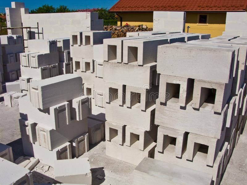 New home under construction, walls made of aerated concrete blocks. Construction and real estate house concept. Stack of the special bricks for walls to be stock photos