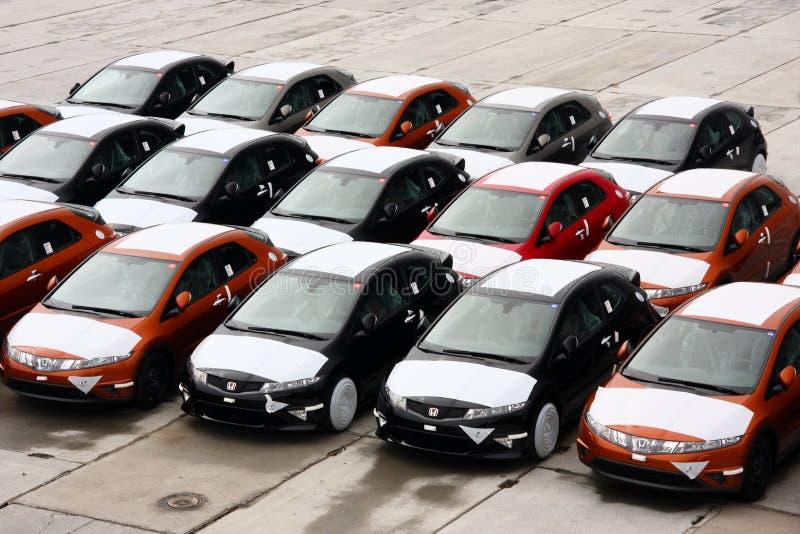 New stock Hondas at port. A photo of brand new Honda Civics at warehouse stock images