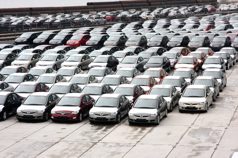New Hondas in stock at a port. A photo of new Honda Civics in a warehouse at a port royalty free stock images