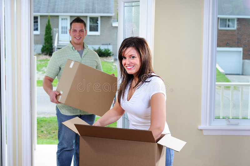 New House. Young Attractive Couple Moving Into Their First Home