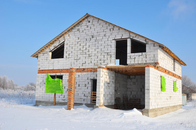 New House building from autoclaved aerated concrete blocks. Winter house construction site stock photography