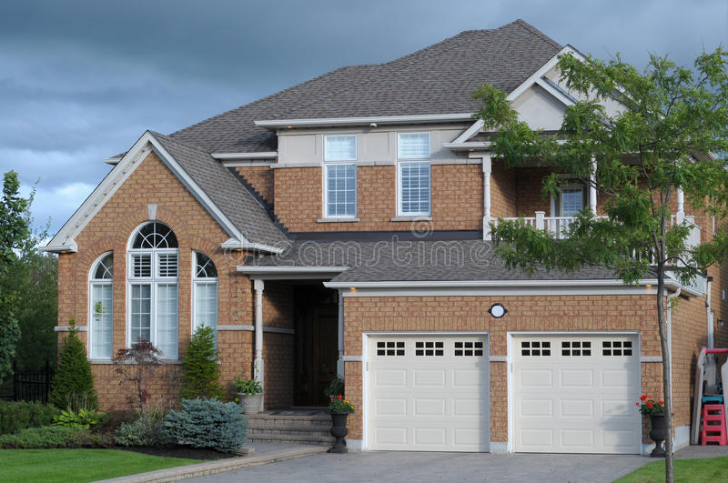 New house with a double garage stock image image of door for Brick garages prices
