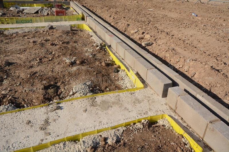 New house footings and groundwork for building construction. Groundwork and steel re-inforcement for concrete base on building construction site where new homes stock photos