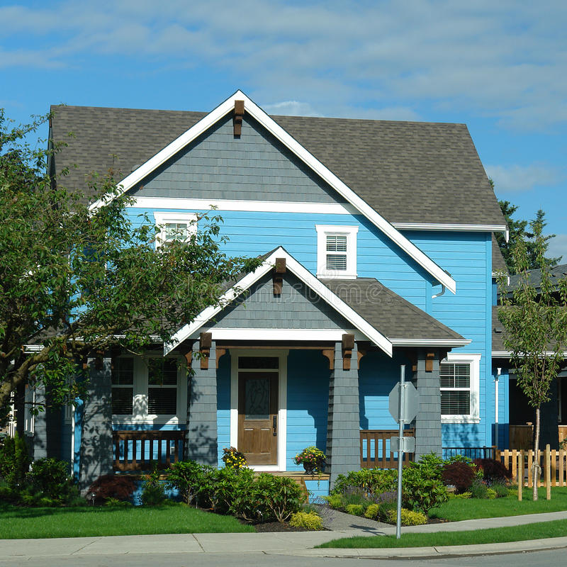 New House Home Exterior Bright Blue. Exterior front view of a bright blue house stock photography
