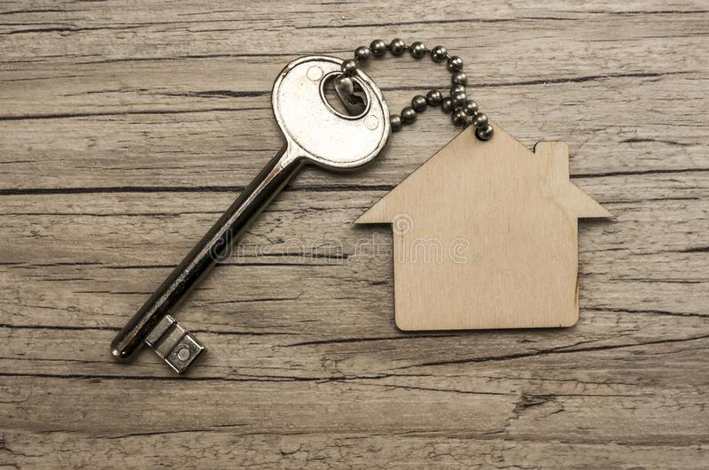 New house key. House key with wooden house key chain stock photography