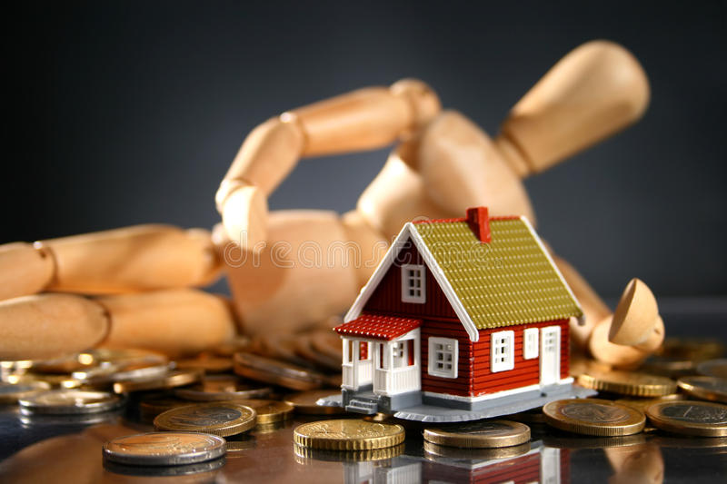 New house owner. New house owner concept. House wooden man and money royalty free stock photography