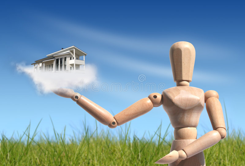 New house owner concept. Wooden people giving new house. Buying new house concept royalty free stock photos
