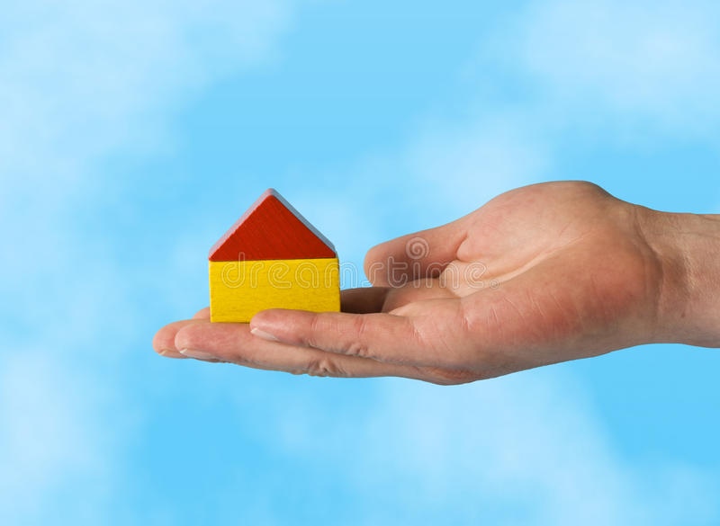 New House On Palm Of Hand Royalty Free Stock Images