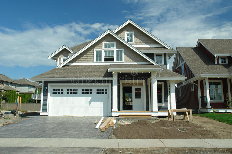 New House With Sold Sign. New blue house front view royalty free stock image