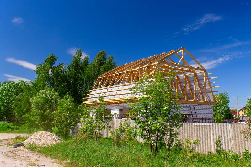A new house under construction in countryside stock photo