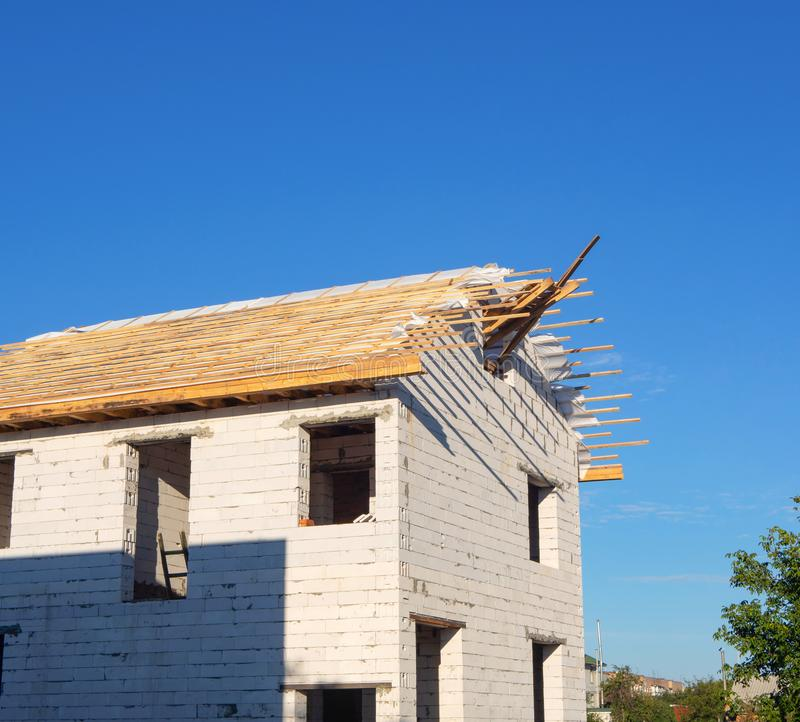 New house under construction with missing windows and unfinished roof. House frame royalty free stock photo