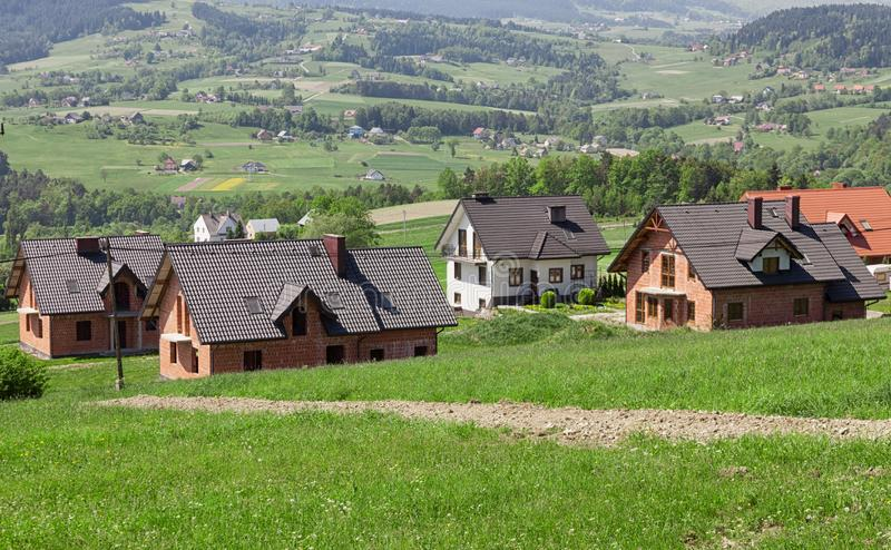 A new housing estate under construction. A housing estate for new homes in the periphery. mountainous terrain, Building home. A new housing estate under stock image