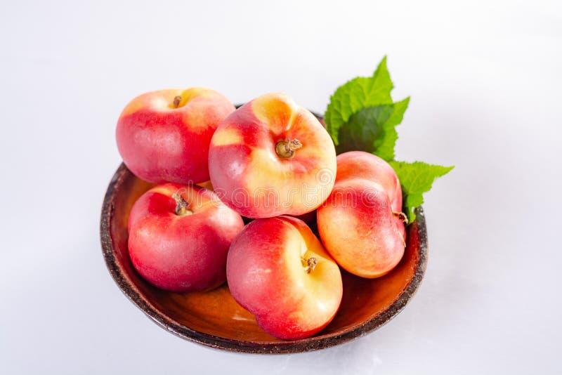 New hybrid sweet fruit nectarina platerina, flat Saturn or donut nectarine peaches close up stock image