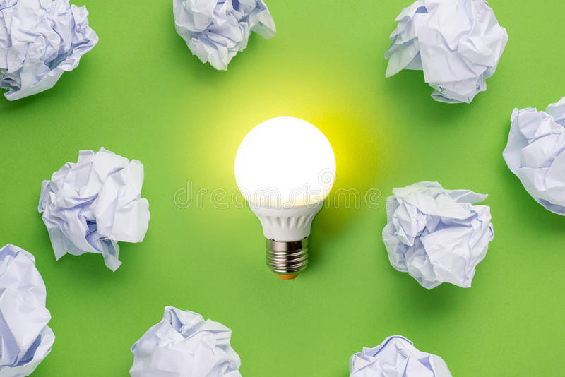 New idea concept with crumpled office paper and light bulb royalty free stock photography