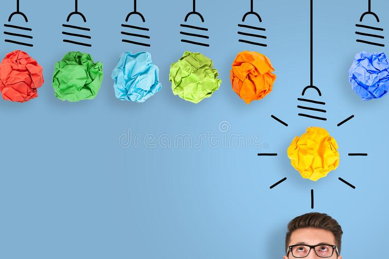 New Idea Concepts Light Bulb with Crumpled Paper on Blue Background stock photo