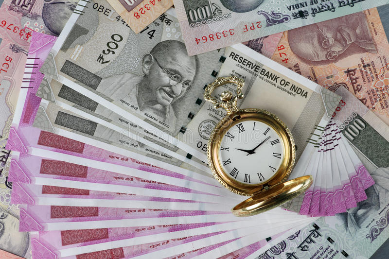 New Indian Rupees Currency with antique time watch. New Indian Rupees Currency with antique watch royalty free stock image