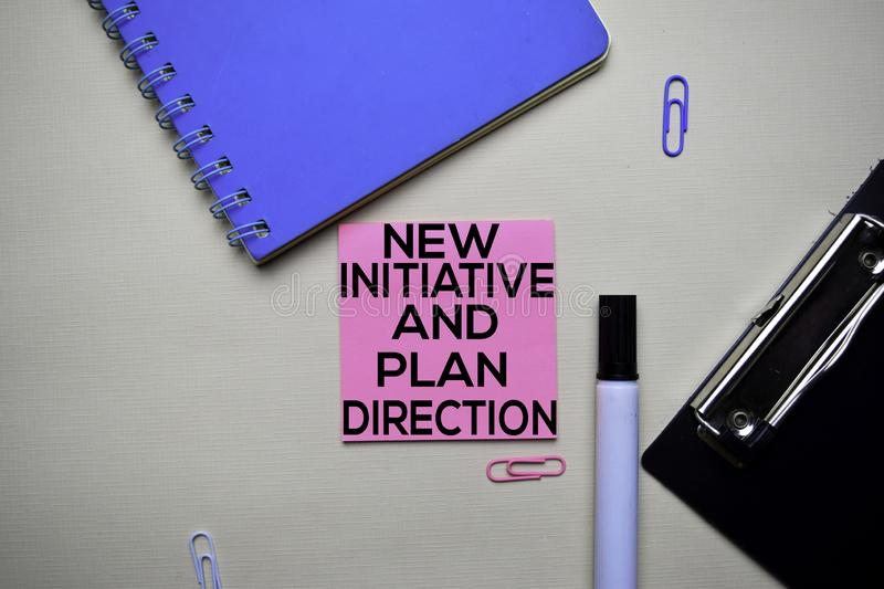 New Initiative and Plan Direction text on sticky notes with office desk concept stock photos