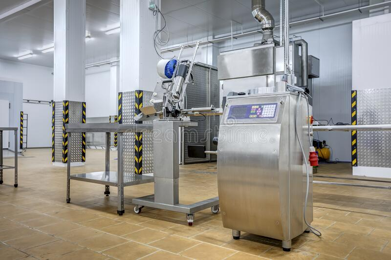 New interior of a packaging production line at a semi-finished factory. Interior of a packaging production line at a semi-finished factory royalty free stock photo