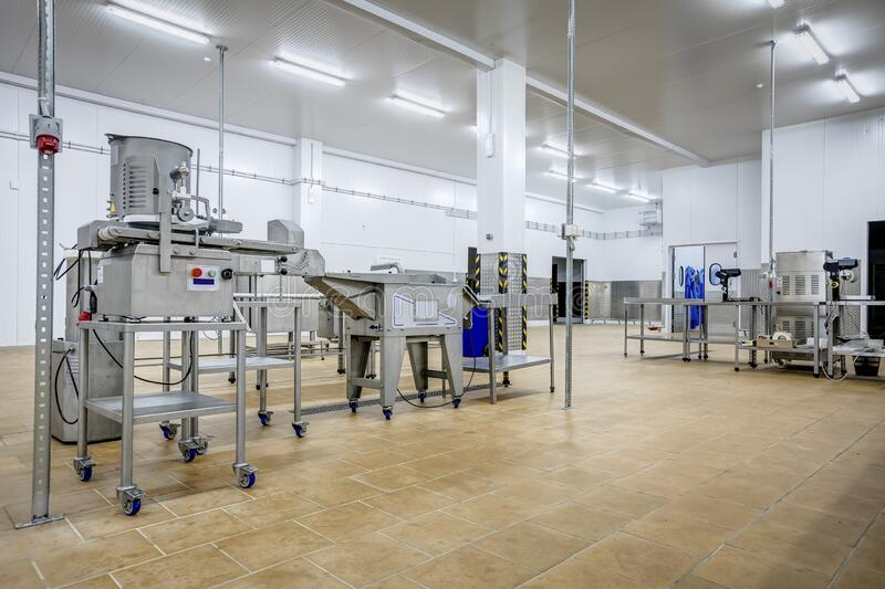 New interior of a packaging production line at a semi-finished factory. Interior of a packaging production line at a semi-finished factory stock photo
