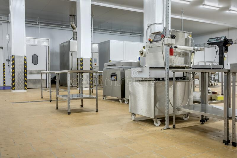 New interior of a packaging production line at a semi-finished factory. Interior of a packaging production line at a semi-finished factory stock photography