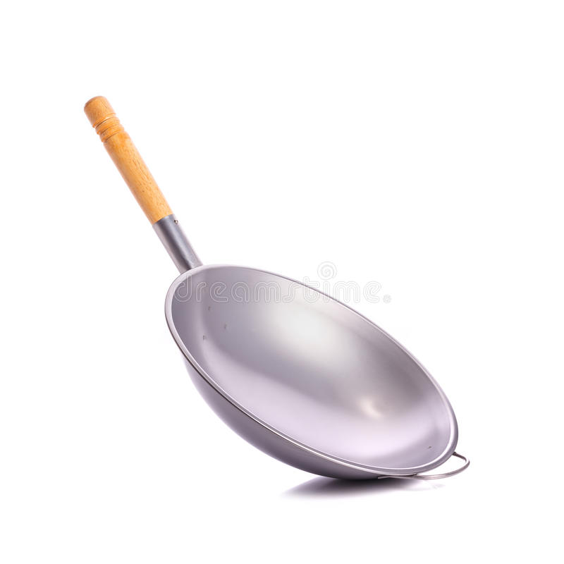 New iron pan with wood handle. Studio shot on white bac royalty free stock images