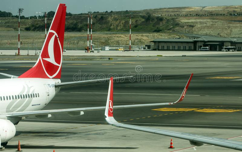 Turkish Airlines TC_JVN commercial airplane and another docked at gates at the New Istanbul Airport, Turkey. royalty free stock photo